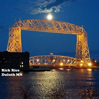 Moonlit Aerial Lift Bridge Image by Rick Rice