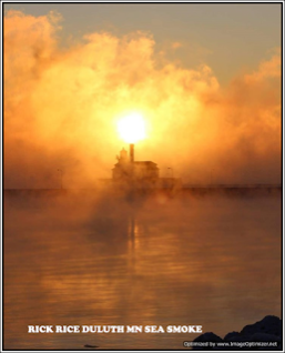 sunrise and sea smoke hides the city's steam power plant