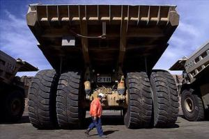 A human walks behind a Self Driving Truck at Rio Tinto Mine Australia Google Images CCL