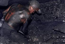 Coal miner shoveling coal. His back was black from the tar black coal dust. via Google Images