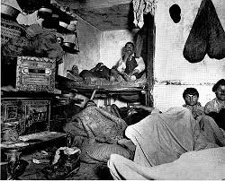 A bunkhouse overfilled with miners. Miserable quarters. Google Images
