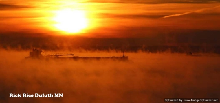 Motor vessel of the American Steamship Co preparing to enter the Port of Duluth MN thru Lake Superior's Sea Smoke Image by Rick Rice