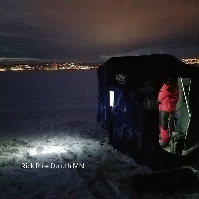 ice fishing with the Duluth MN skyline as backgroup Image by Rick Rice Duluth MN