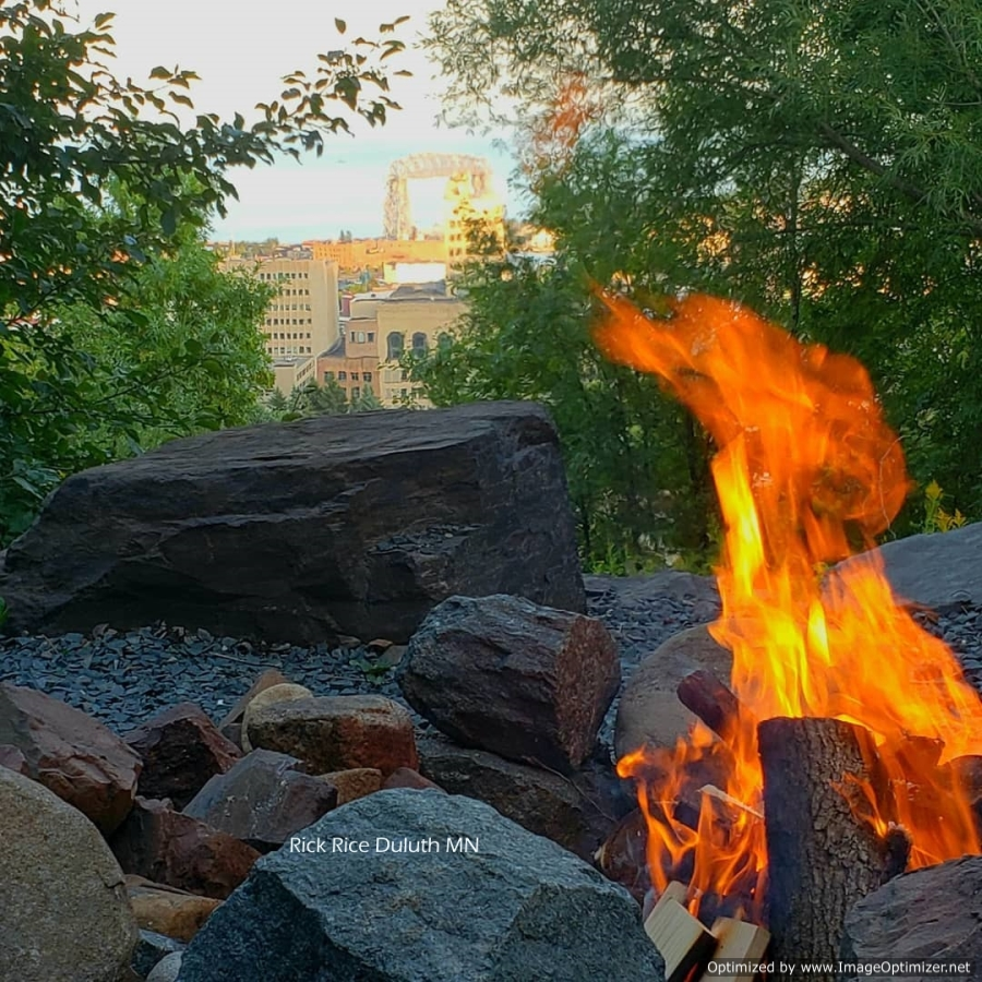 Campfire overlooking the city of Duluth Rick Rice Photographer