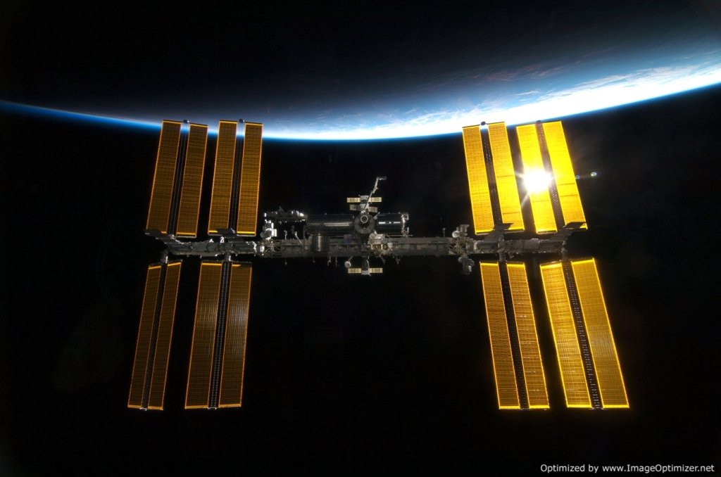 A fabulous picture of the International Space Station. Its panels are caught some in full sun and some in partial. Amazing picture. I do not remember where I found it.