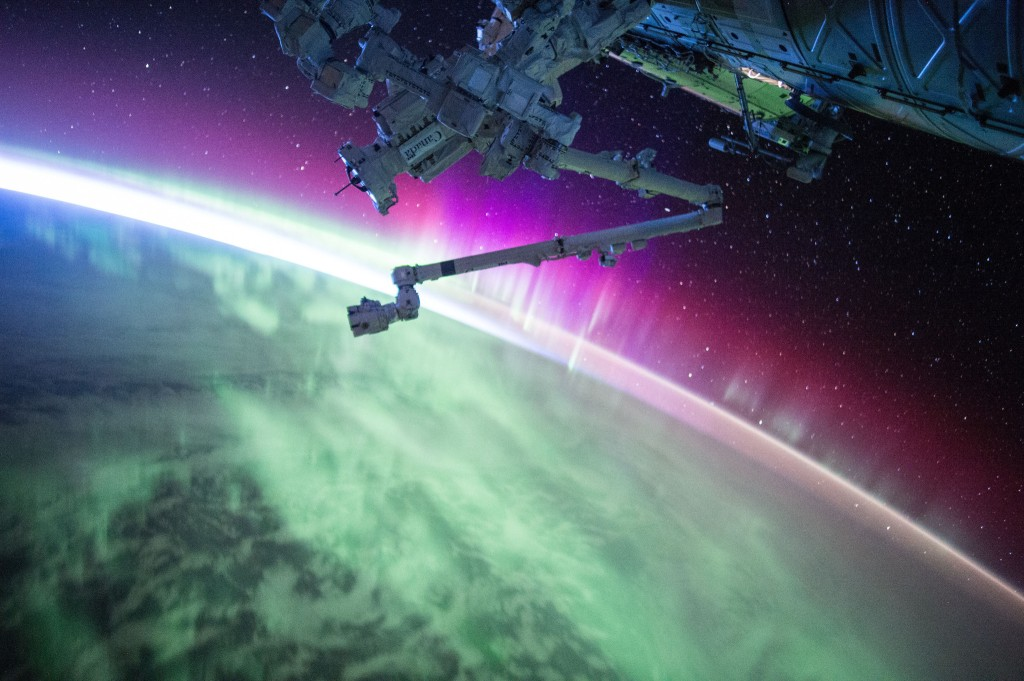which is more dramatic the International Space Station traveling thru the Aurora Borealis Image by Scott Kelly NASA