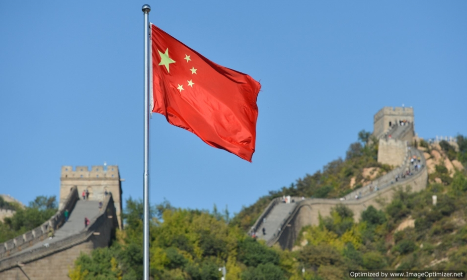 China's flag over the Great Wall. Image credit Tobias Ellwood